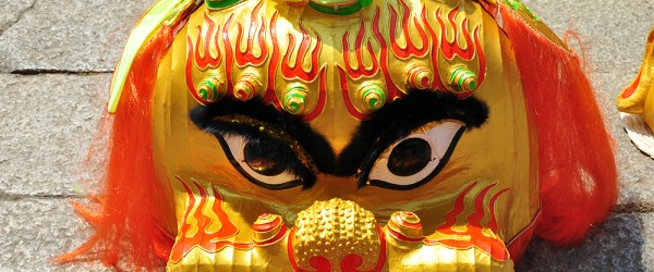 Closeup of a Lion dance mask on the ground